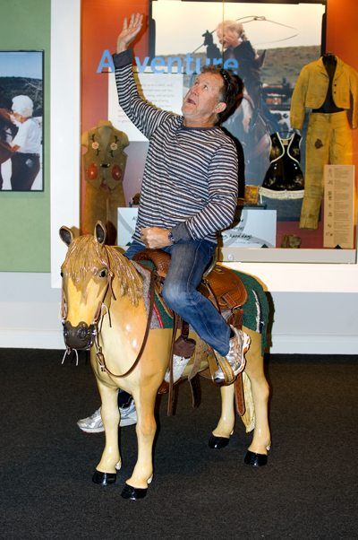 Pops riding on a little pony